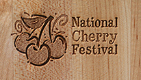 Laser engraved corporate branding: cutting boards for The National Cherry Festival's culinary events.